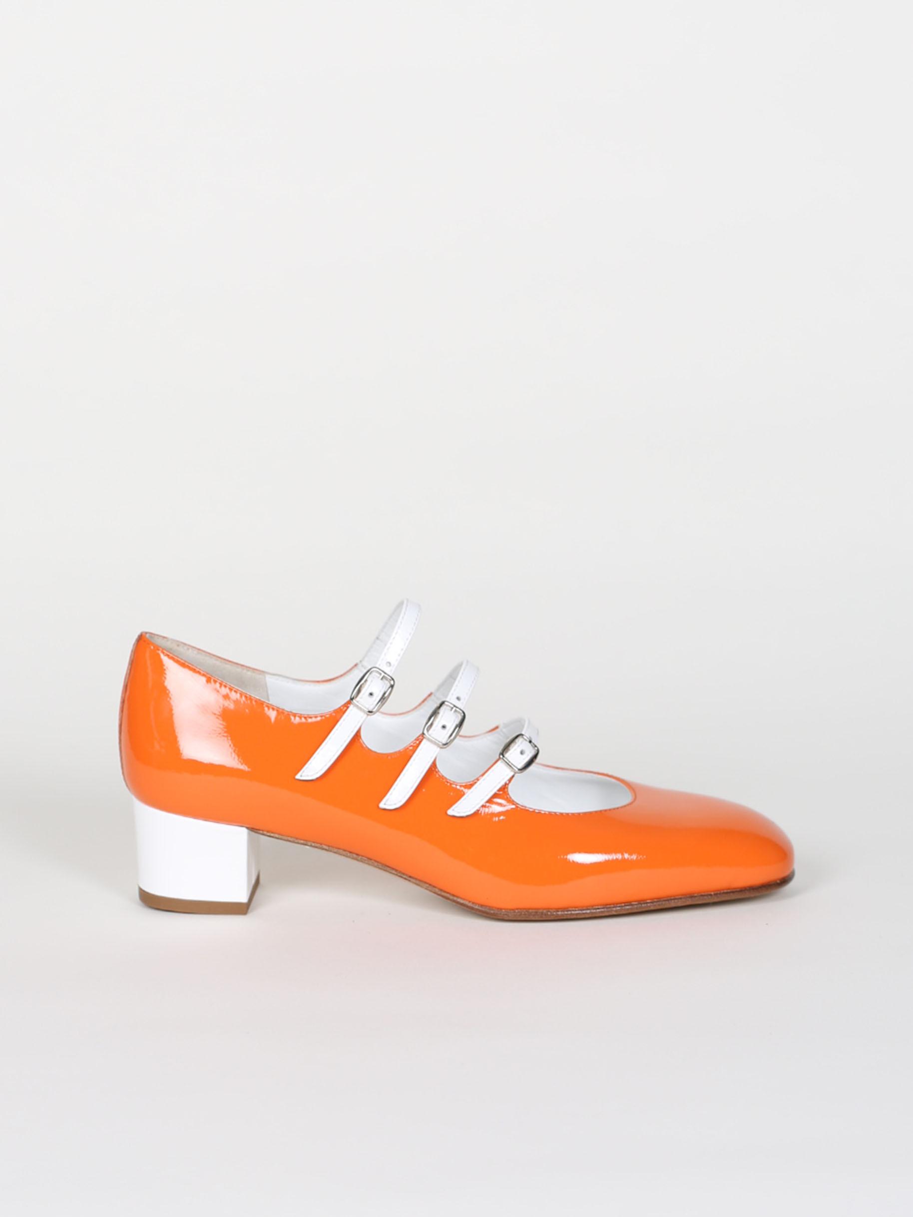 Orange and white patent leather Mary Jane